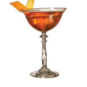 The vintage 1924 coupe glass with a cocktail.