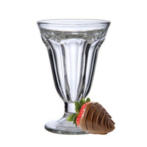 The dessert sundae glass with a chocolate strawberry.