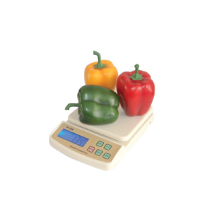 An electric compact scale with peppers on top.