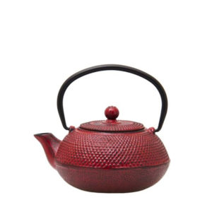 A red cast iron Chinese teapot.