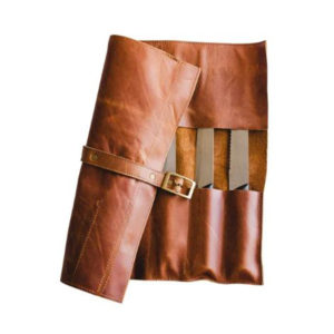 Semi rolled out leather knife bag showing safety buckle.