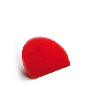 A plastic dough scraper red.