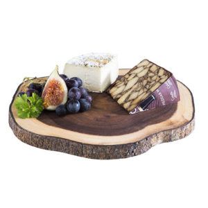 An Acacia wood platter with cheese and fruit.