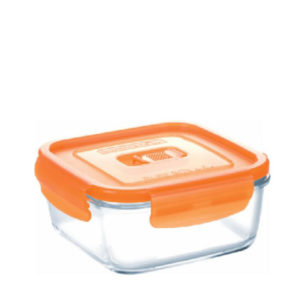 An oven proof glass lunch box with orange lid.